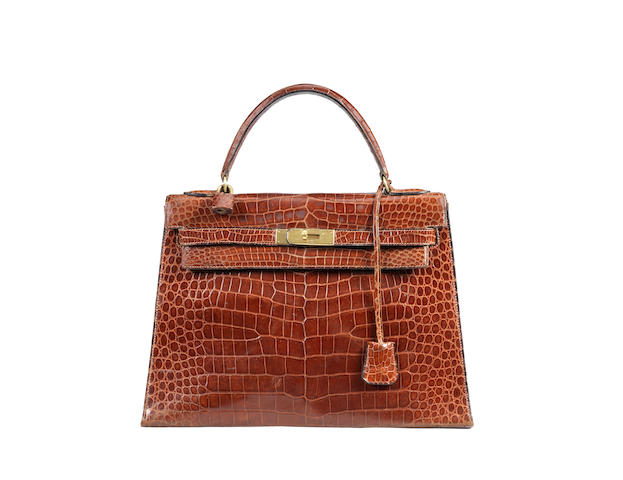 An Hermes brown crocodile Kelly bag