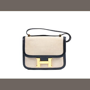 An Hermès navy leather and toile Constance bag