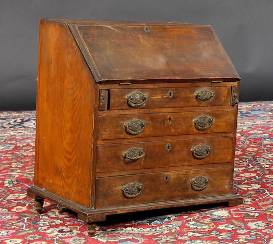 A miniature oak bureau In need of restoration