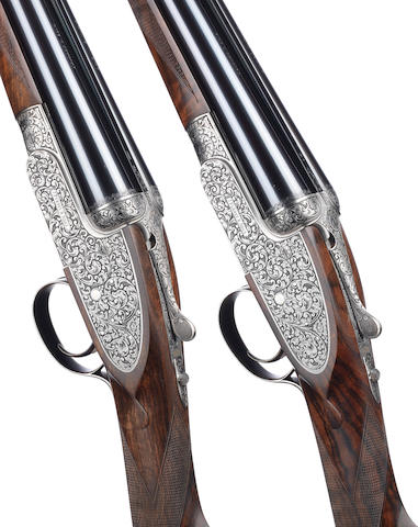 A fine pair of M. Smith-engraved 20-bore (2¾in) single-trigger self-opening sidelock ejector guns by J. Purdey & Sons, no. 30441/2