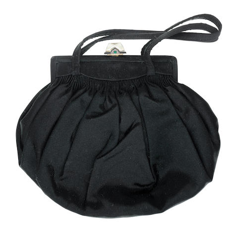 A silk, rock crystal, enamel, emerald and diamond evening bag