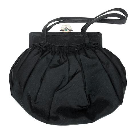 A silk, rock crystal, enamel, emerald and diamond evening bag