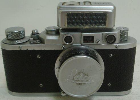 Leica camera with Ernst Leitz Gmbh Wetzlar lens, with Kodak Lodalux L light meter reader in leather case.