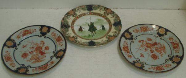 A pair of Ironstone china plates, floral and insect decorated with a Japan pattern, 26cm and a Royal Doulton Series ware plate. (3)