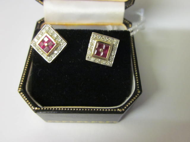 A pair of ruby and diamond ear studs,