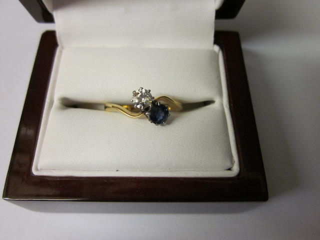 An 18ct gold sapphire and diamond crossover ring,