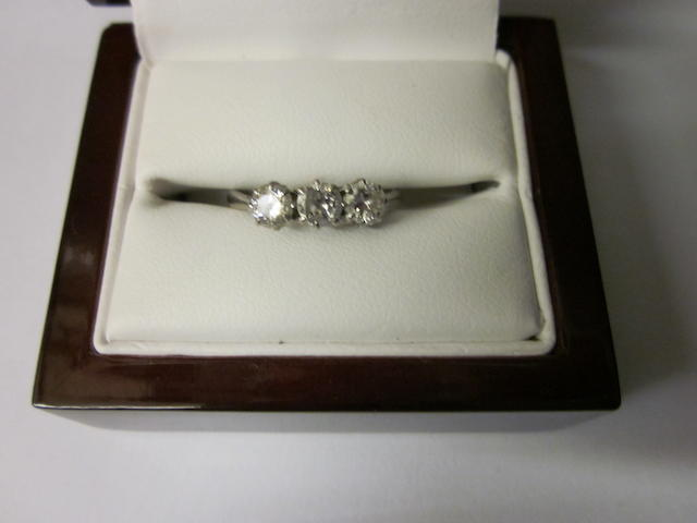 A 18ct white gold and platinum three stone diamond ring,