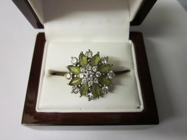 An 18ct gold peridot and diamond cluster ring,