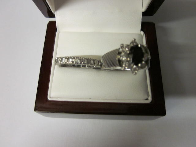 An 18 carat white gold sapphire and diamond cluster ring, (2)