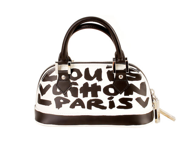 A Louis Vuitton monotone graffiti mini Alma bag