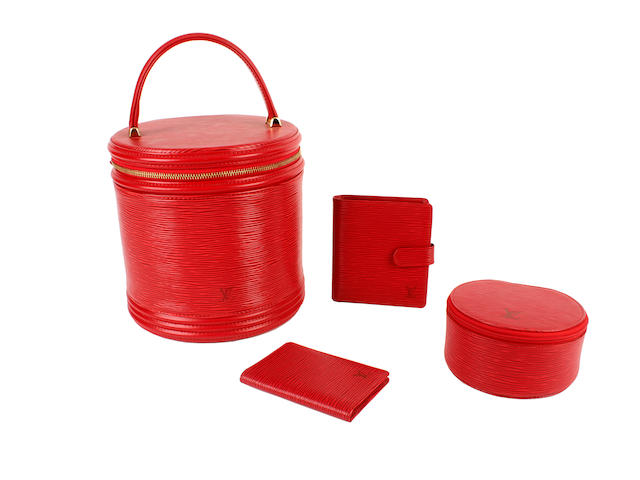 Four Louis Vuitton red epi leather items