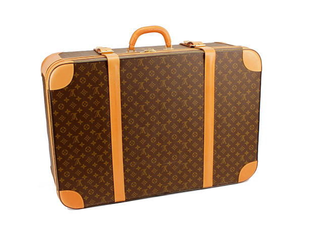 A large Louis Vuitton brown and tan monogram suitcase