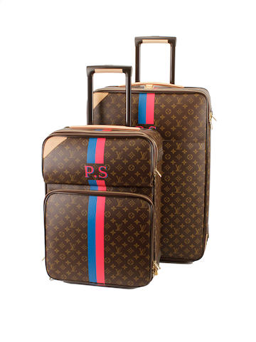 Two initialled Louis Vuitton brown and tan monogram rolling suitcases