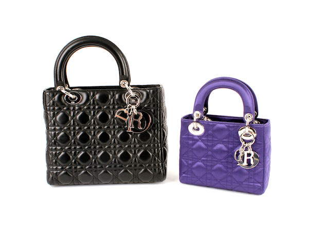 Two Lady Dior bags - one in black leather and one in purple satin (2)
