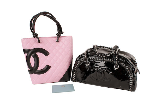 A Chanel pink quilted monogrammed tote bag, a black patent bowler bag and a blue card holder