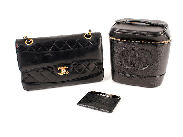 A Chanel black leather 2.55 bag, a black cube form vanity case and a black card holder