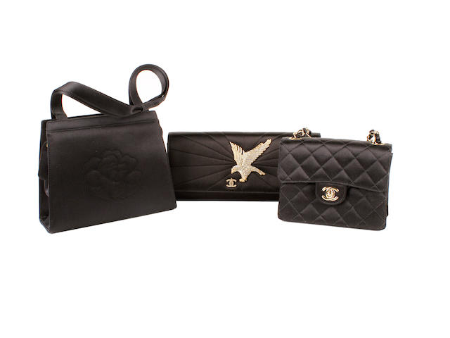 Three Chanel black satin bags