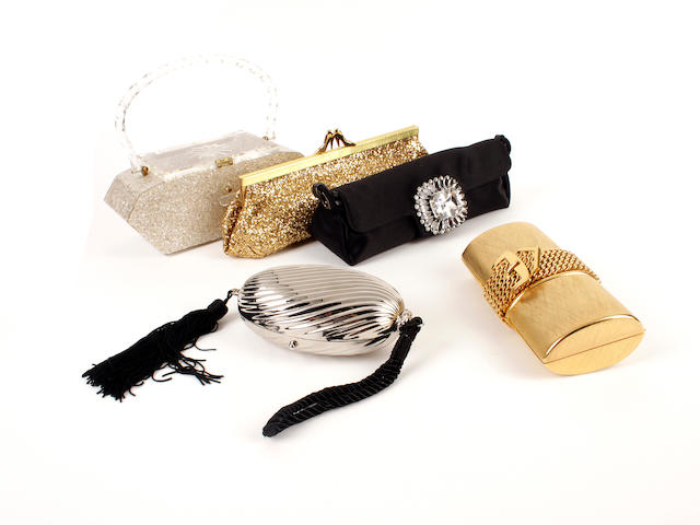 Five designer evening bags - a black satin and diamanté Jimmy Choo bag, a Maud Frizon golden glitter bag, a hardcase golden clutch, a hardcase silver coloured oval bag and a glitter perspex rigid bag