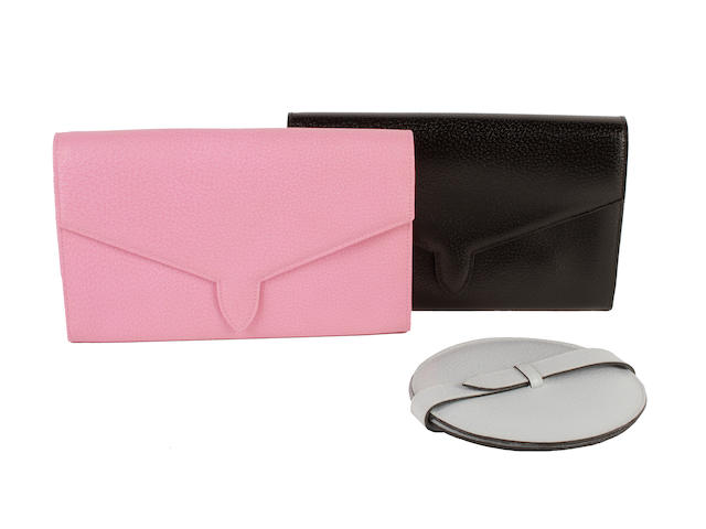 Three Smythson items - a pink pigskin travelling wallet and a matching black example and a blue pigskin covered mirror (3)