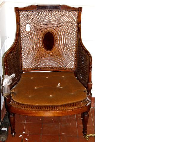 A Georgian style inlaid mahogany bergere armchair