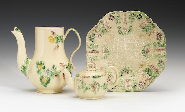 An early Creamware plate, tea pot and cover and a coffee pot, circa 1750-55