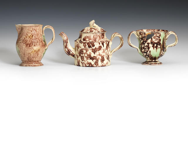 A Staffordshire creamware teapot and cover, a loving cup and a jug, circa 1765-80