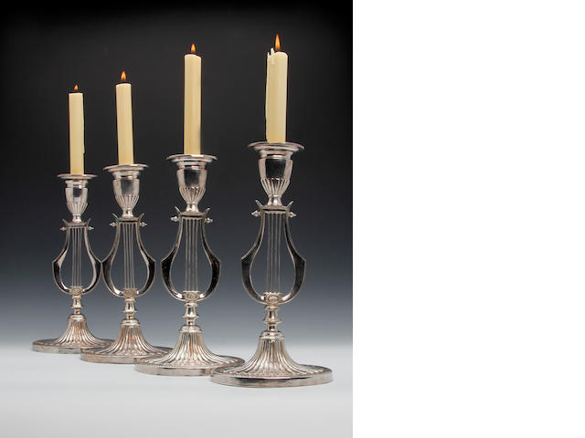 A set of six Old Sheffield plate candlesticks, unmarked,  (6)