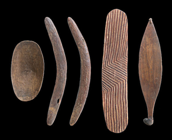 A Collection of Artefacts, Western Australia Boomerangs: 61 and 60cm; Wunda Shield: 69.5cm; Spearthrower: 59.5cm and Coolamon: 34.5 by 9cm