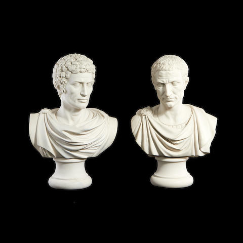 A pair of composition marble Classical busts