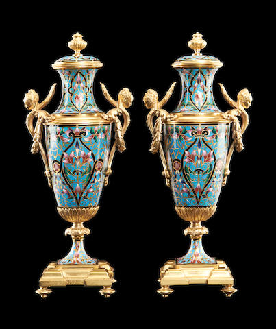 A pair of late 19th century French champlevé enamel and gilt bronze urns