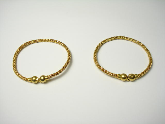 A pair of Indian high carat gold bangles of flexible corded mesh links 43.5g 22ct?