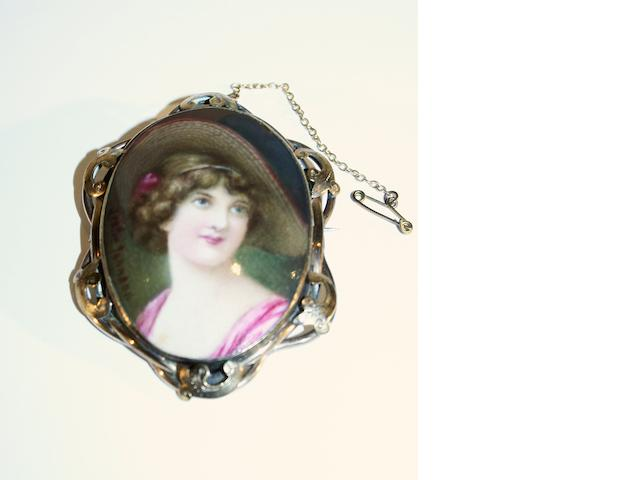 Burslem Items A Royal Doulton hand painted brooch, painted by Leslie Johnson, Circa 1910