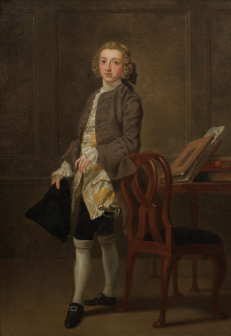 Francis Hayman (Exeter 1708-1776 London) A full length portrait of John Barber wearing a brown Jacket and Breeches, and a yellow Waistcoat, holding a Tricorn Hat and standing in front of a Chair and Table oil on canvas 24½ ins x 17 ins  in carved giltwood frame  Exhibited: Agnews