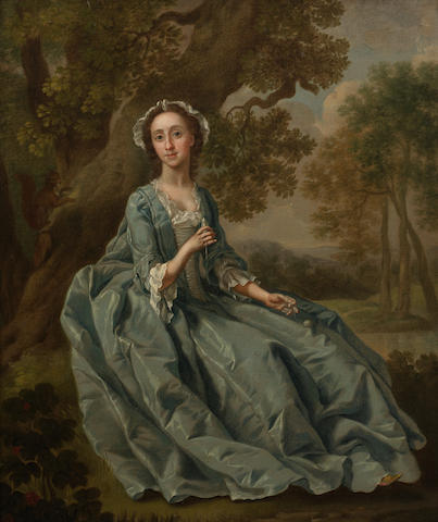 Francis Hayman (Exeter 1708-1776 London) A Seated Portrait of Elizabeth Barber wearing a Blue Dress and a white Lace Bonnet, Holding a Needle and Thread and seated beneath a Tree with a Landscape Beyond oil on canvas 24 ins x 20 ins  in carved giltwood frame  Exhibited: Agnews