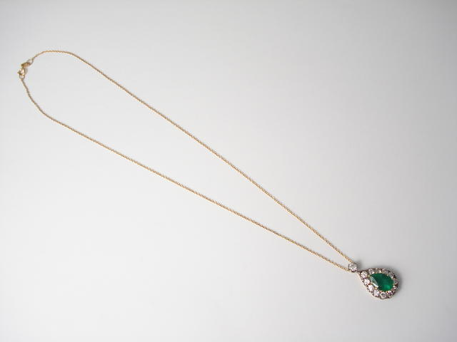 An emerald and diamond pendant