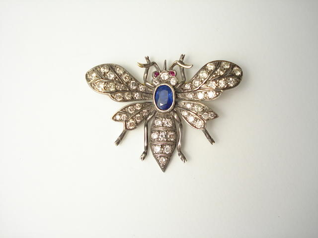 A diamond, sapphire and ruby bee brooch