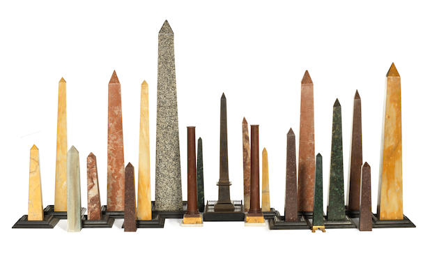 A group of twenty one Italian Grand tour specimen marble and hard stone obelisks and columns including a patinated bronze model of the Luxor obelisk