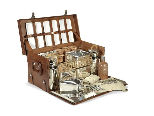 A superb leather-cased picnic set for six-persons, with sterling silver accessories, by Drew & Sons, 1914,