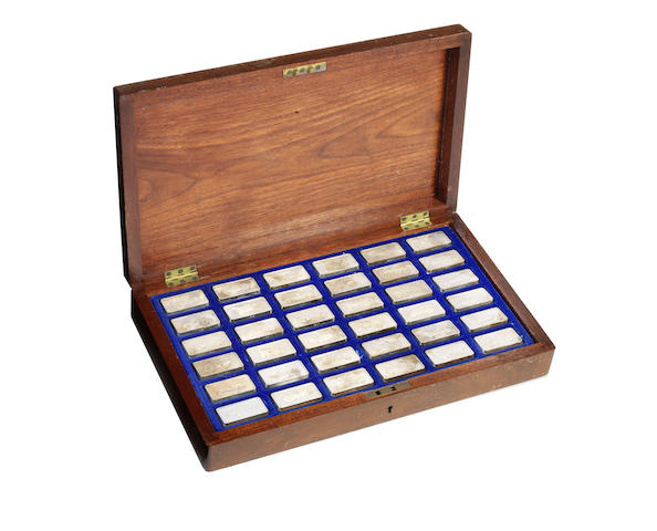 A cased set of 36 sterling silver commemorative motoring ingots, by John Pinches Ltd,