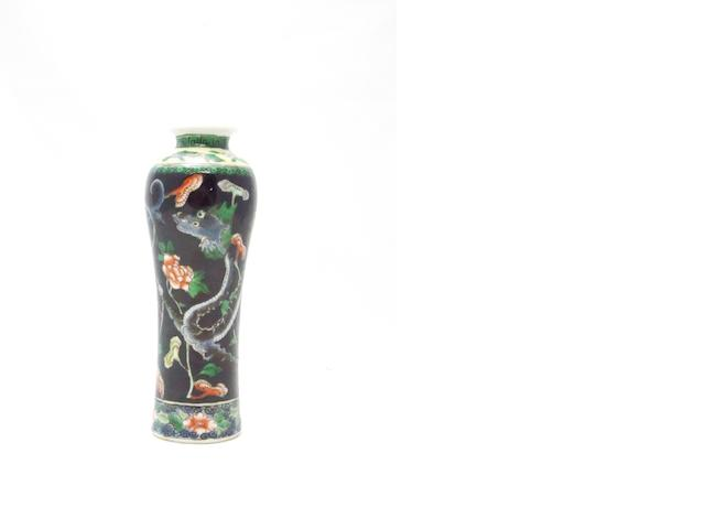 A small famille noir vase