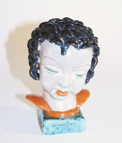 A Goldscheider bust of a young girl  Circa 1935
