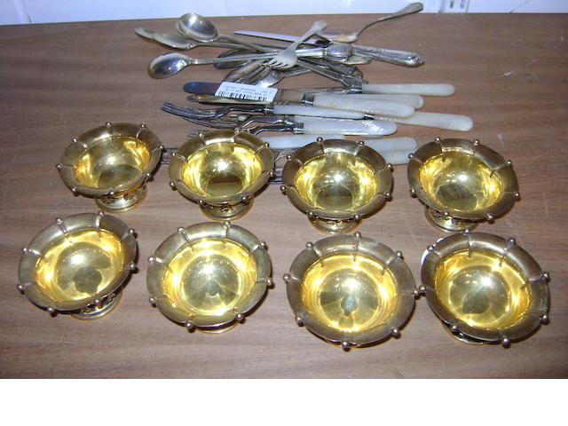 A set of eight gilt metal bon bon dishes