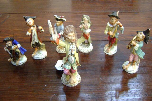 Seven Sitzendorf monkey band figures,