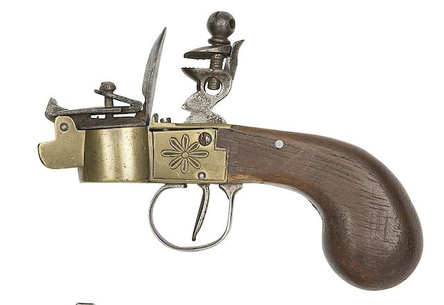 A Continental Flintlock Box-Lock Tinderlighter, A North African Toe-Lock Mechanism From A Longarm, And Six Various Continental Powder- And Shot-Flasks