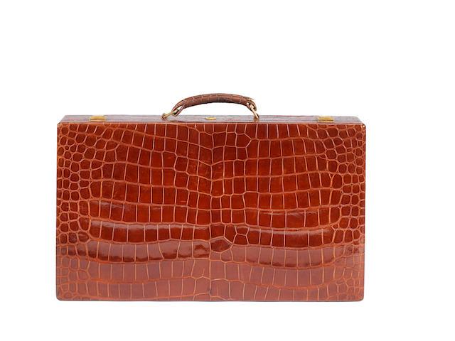 An Hermes croc jewellery case
