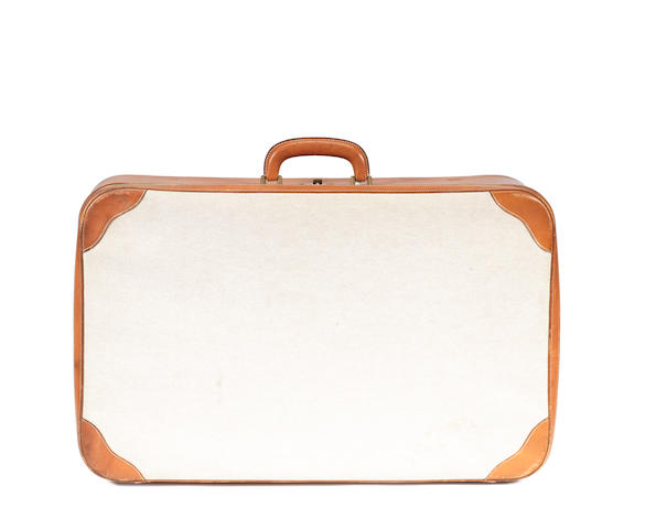 An Hermès cream toile and tan leather suitcase
