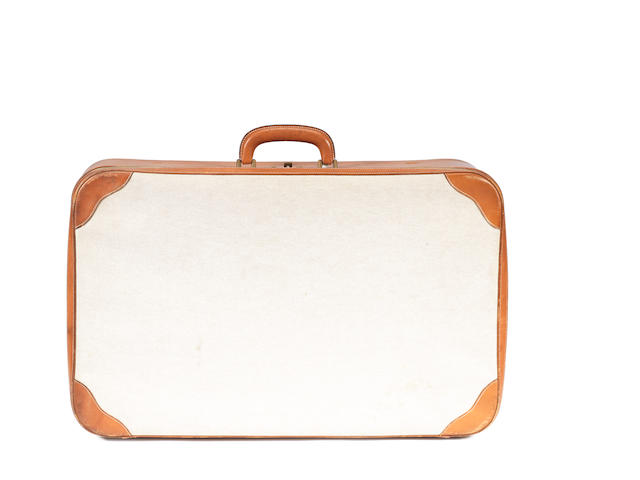 An Hermes toile and leather suitcase