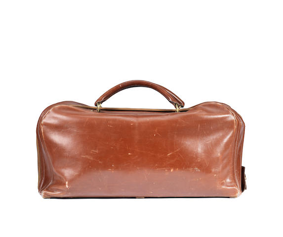 An Hermes brown leather suitcase
