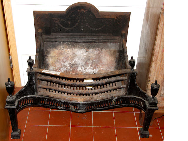 A George III style cast iron fire grate,