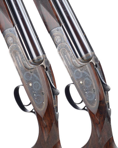 A fine pair of 20-bore (2¾in) single-trigger over-and-under sidelock ejector guns by J. Purdey & Sons, no. 29333/4 In their leather motor-case, and together with their original pistolgrip stocks